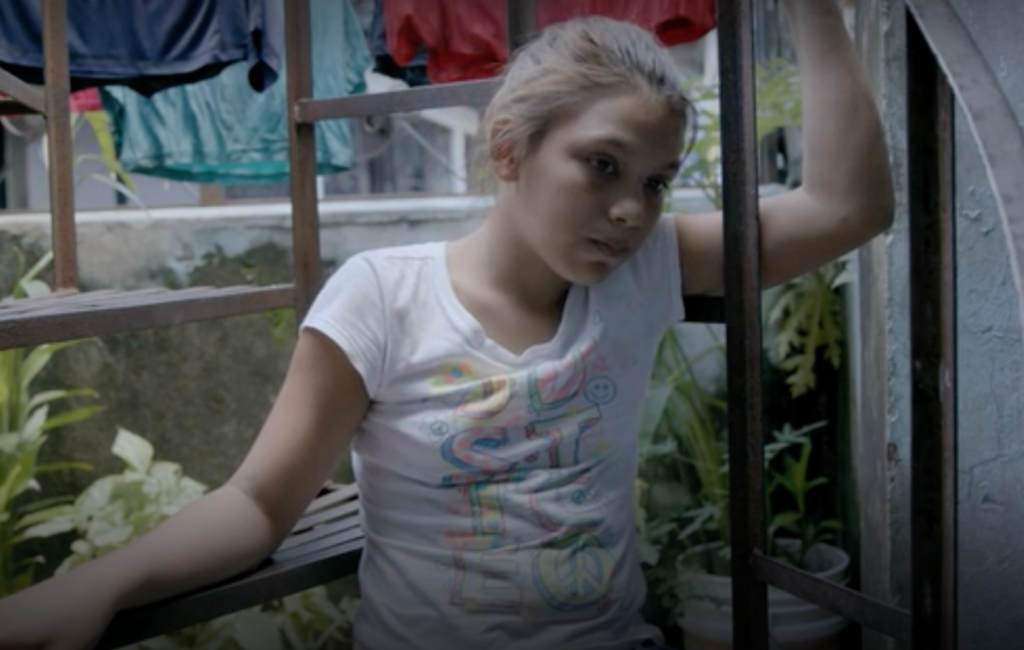 Elena, a 14-year-old Honduran refugee fleeing gang and sexual violence in her country.